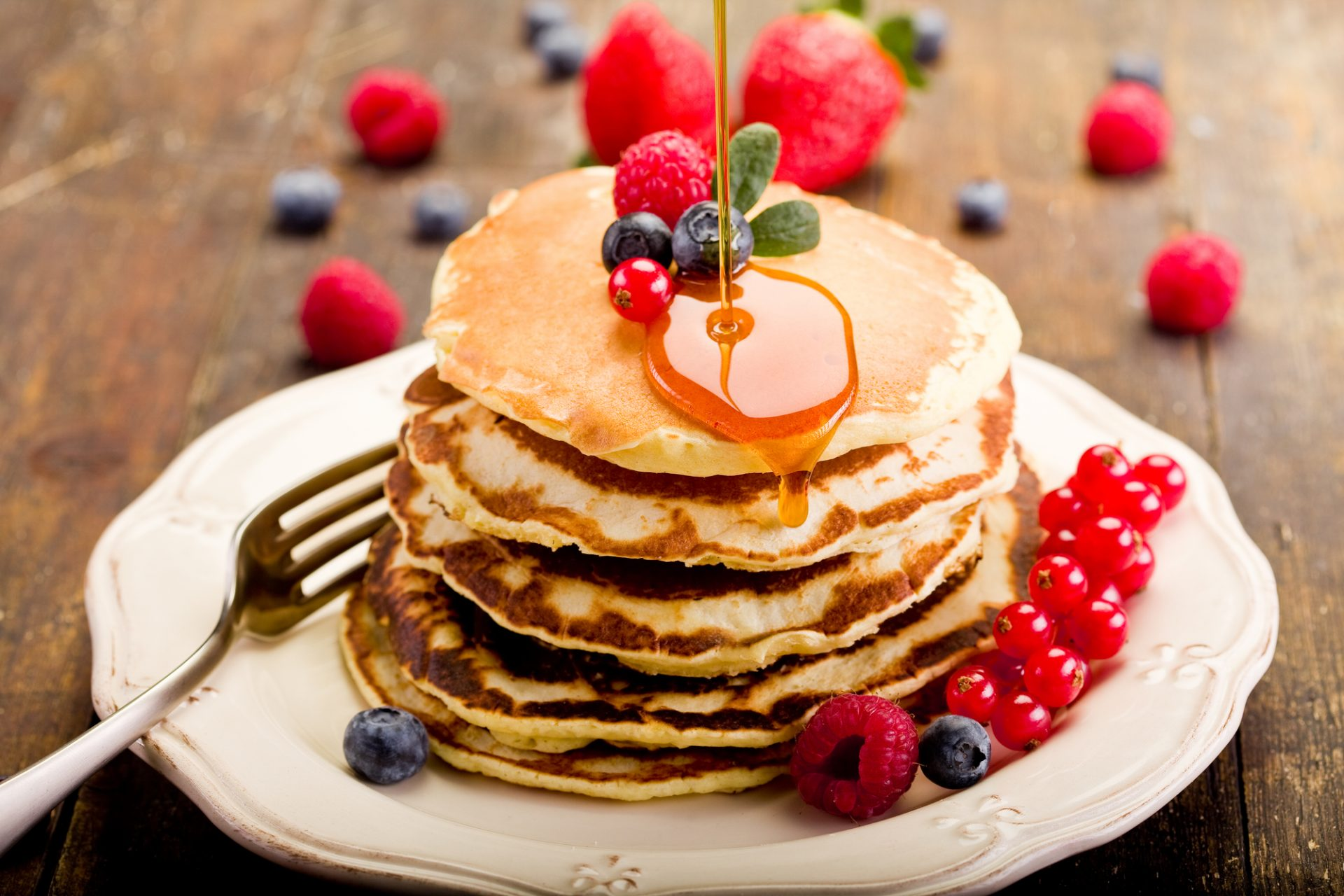 pancakes syrup and berries